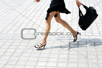 detail caucasian woman legs running in the street
