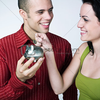 young couple saving