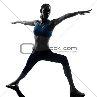 woman exercising yoga warrior position 2
