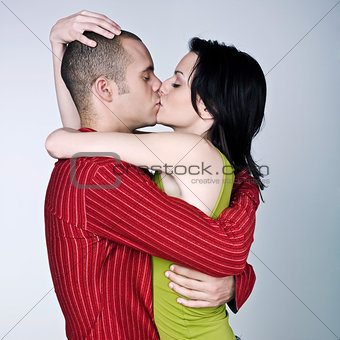 young couple hugging kissing