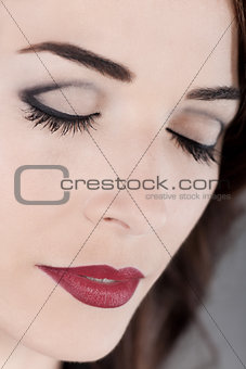 Beautiful woman eyes closed and red lips close up