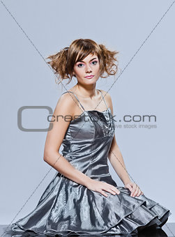 beautiful young girl with prom dress sitting full length