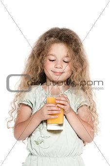 Little girl portrait orange juice drink