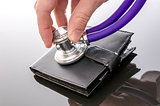 Checking a wallet with a stethoscope