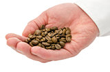 Male hand holding coffee beans