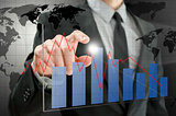 Business man pointing at interactive business graph
