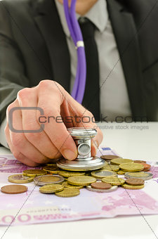 Financial adviser checking money with stethoscope