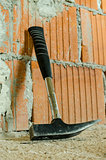Hammer leaning on brick wall