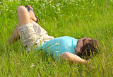 Man laying on grass field Summer day Relaxation Outdoor Leisure Time on Nature