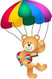 Teddy bear parachute holding heart