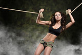 sexy girl tied by rope on militry background