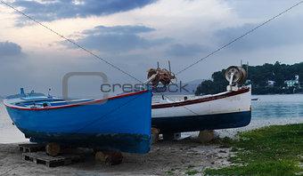 Boats under an evening sky