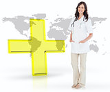 Nurse standing by digital yellow cross