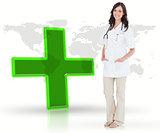 Nurse standing by digital green cross