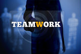 Silhouette of woman touching teamwork button
