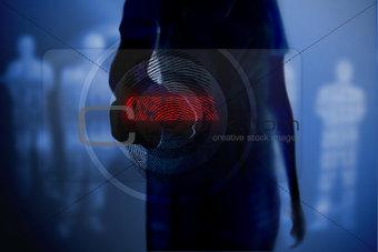 Silhouette of woman touching fingerprint button