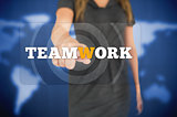 Businesswoman touching teamwork button
