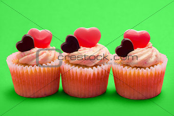 Three valentines cupcakes in a row