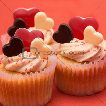 Close up of three valentines cupcakes