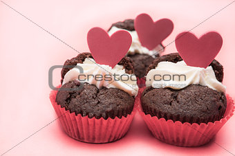 Three chocolate valentines cupcake with heart decorations