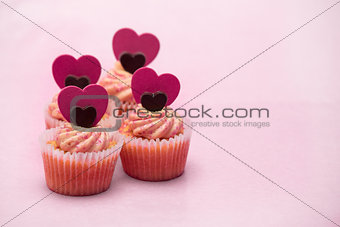 Four valentines muffins with heart decorations