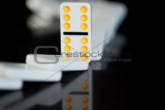 One yellow domino left standing