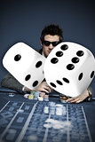 Gambler in sunglasses with digital dice in foreground