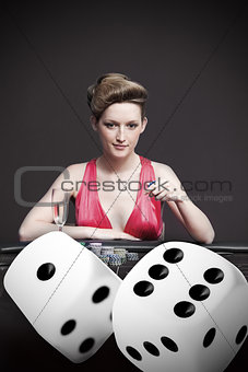 Attractive gambler betting on digital dice