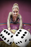 Blonde woman grabbing chips with digital dice