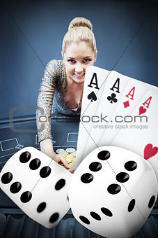 Blonde woman grabbing chips with digital hand of four aces and dice