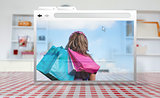 Digital internet window showing girl with shopping bags