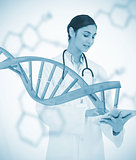 Doctor using tablet pc with graphic dna helix