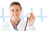 Smiling doctor holding up stethoscope