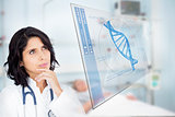 Doctor studying virtual screen showing DNA helix