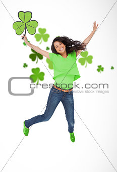 Girl jumping with shamrocks