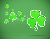 Green shamrocks on green background