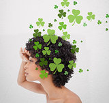 Girl looking into distance with shamrocks
