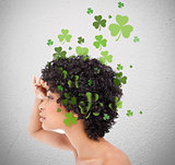 Girl looking into distance with shamrocks coming from her hair