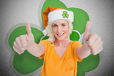 Girl in orange tshirt giving thumbs up on shamrock background