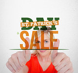 Bold text advertisement for st patricks day sale with smiling blonde