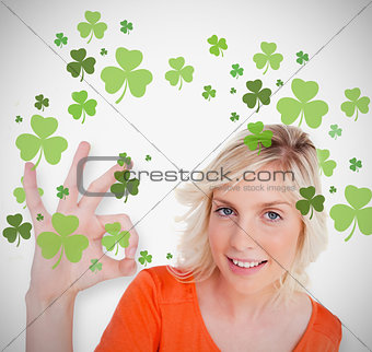 Blonde giving ok symbol for st patricks day and smiling