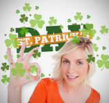 Blonde giving ok symbol for st patricks day with text and shamrocks