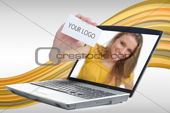 Woman reaching out from laptop showing business card