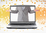 Businessman reaching his arms out from laptop