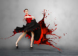 Flamenco dancer with dress turning to paint splattering