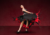 Flamenco dancer with dress turning to paint splatter