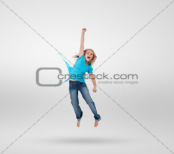 Little girl jumping with clothes turning to paint splashes