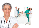 Smiling doctor with patient in bed and medical staff behind him