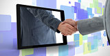 Businessman reaching out from tablet and shaking hands with other man