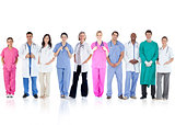 Happy team of doctors standing together in a line